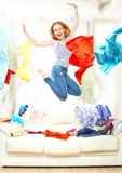 Funny girl with flying clothes jumping at home Royalty Free Stock Photography