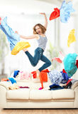 Funny girl with flying clothes jumping at home Stock Photos