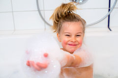 Funny girl with foam bathtub in the bathtub Royalty Free Stock Images