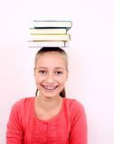 Funny girl with four books on head Stock Image