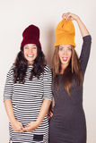 Funny girl friends with wool caps Royalty Free Stock Photography