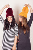 Funny girl friends with wool caps Royalty Free Stock Image