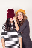 Funny girl friends with wool caps Stock Image