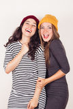 Funny girl friends with wool caps Royalty Free Stock Photo
