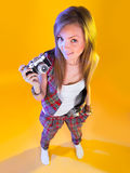 Funny girl in full growth with a camera in hand Stock Photo