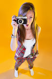 Funny girl in full growth with a camera in hand Royalty Free Stock Image