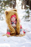 Funny girl in a fur hat in winter forest Royalty Free Stock Images
