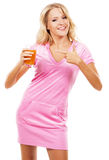 Funny girl with a glass of fresh juice Royalty Free Stock Images