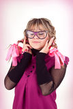 Funny girl in glasses. An image of a funny girl in big glasses royalty free stock images