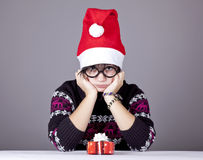 Funny girl in glasses with christmas gifts. Studio shot stock image
