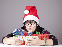 Funny girl in glasses with christmas gifts. Studio shot royalty free stock photos