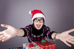 Funny girl in glasses with christmas gifts. Studio shot stock photos