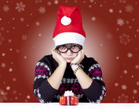 Funny girl in glasses with christmas gifts. Studio shot stock images