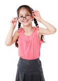 Funny girl in glasses. Funny girl holding a glasses, isolated on white royalty free stock image