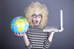 Funny girl in glasses keeping notebook and globe. Studio shot royalty free stock photography