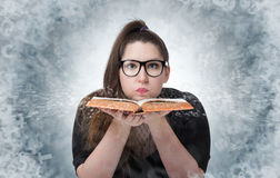 Funny girl in glasses with open book, concept education. Funny girl in glasses with open book on background, concept education royalty free stock photography