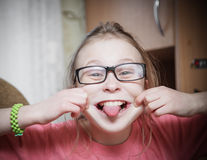Funny girl in glasses. Funny girl in glasses showing tongue stock images