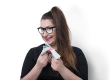 Funny girl in glasses with a stack of money Stock Image