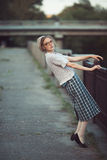 Funny girl with glasses and a vintage dress. Outdoors stock photos