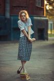 Funny girl with glasses and a vintage dress. Funny girl student with glasses and a vintage dress outdoors stock photo