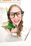 Funny girl with green book Stock Photography