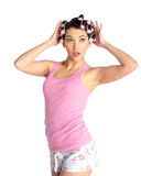 Funny girl with hair curlers on her head Royalty Free Stock Photo