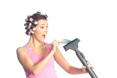 Funny girl with hair curlers on her head Stock Photo