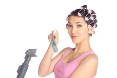 Funny girl with hair curlers on her head Stock Images