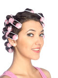 Funny girl with hair curlers on her head Royalty Free Stock Photography