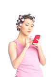 Funny girl with hair curlers on her head Royalty Free Stock Image