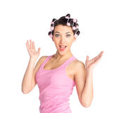 Funny girl with hair curlers on her head Stock Photography