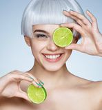 Funny girl with halves of green lime. Healthy & Happy stock images