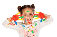 Funny girl with hands and face full of paint Stock Photos