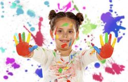 Funny girl with hands and face full of paint Royalty Free Stock Images