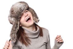 Funny girl in a hat. Winter portrait of young adult girl in a hat Royalty Free Stock Photos