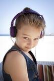 Funny girl with headphones stock image