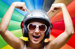 Funny girl in helmet having fun. Multicolored background Stock Image