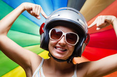 Funny girl in helmet having fun. Royalty Free Stock Photos