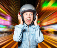 Funny girl in helmet moving on the street Royalty Free Stock Photos