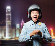 Funny girl in helmet moving on the street Stock Photos