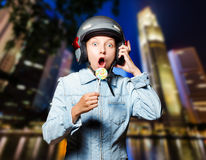 Funny girl in helmet moving on the street Royalty Free Stock Photography