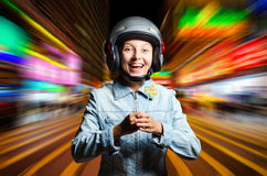 Funny girl in helmet moving on the street Royalty Free Stock Images