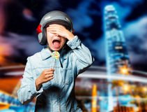 Funny girl in helmet moving on the street Stock Photo