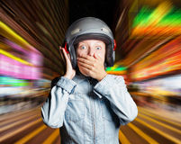 Funny girl in helmet moving on the street Stock Image