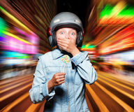Funny girl in helmet moving on the street Stock Photography