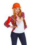 Funny girl in a helmet with roller in hand it is isolated on the Stock Images