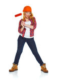 Funny girl in a helmet with roller in hand it is isolated on the Stock Photo