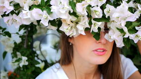 Funny girl hiding behind the bush stock footage
