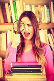 Funny girl holding magnifying glass Royalty Free Stock Photo