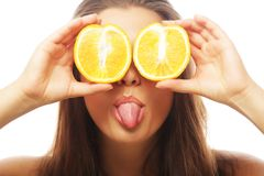 Funny girl holding oranges over eyes. Funny girl portrait, holding oranges over eyes stock image